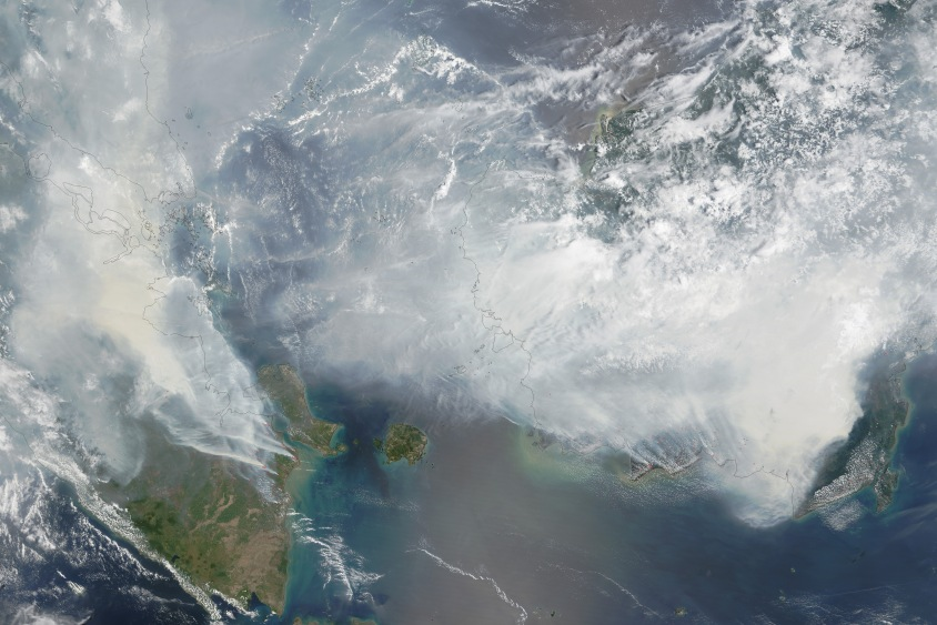 A September 24 image taken from NASA's Terra satellite shows a haze-blanketed Sumatra and Kalimantan