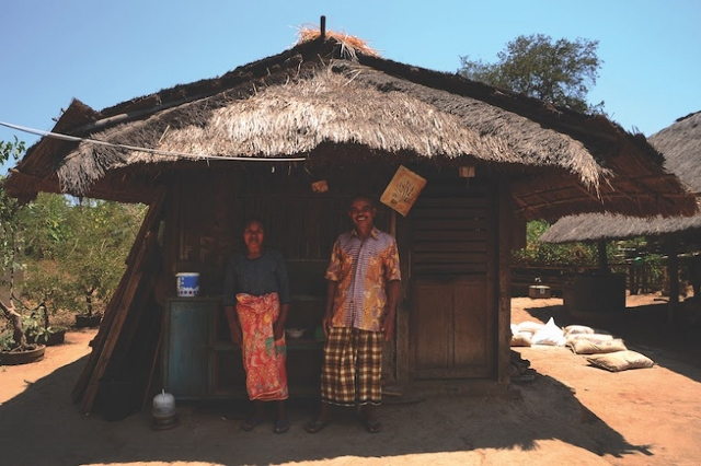 Syahban and his wife in front of their house in West Nusa Tenggara province. Photo: Sonang Elyas/BIRU